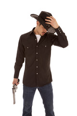 Cowboy holding hat and gun