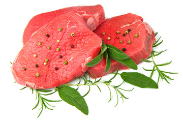 red meat with sage and rosemary  isolated on white background