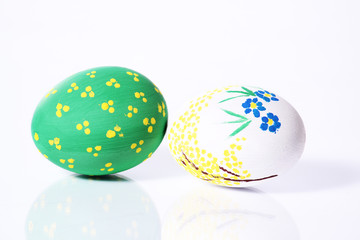 Two painted eggs green and white