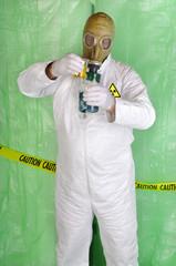 chemical engineer handling hazardous material in clean room