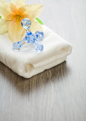 flower and massager on white towel