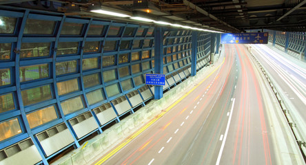 Tunnel with busy traffic at night in Hong Kong