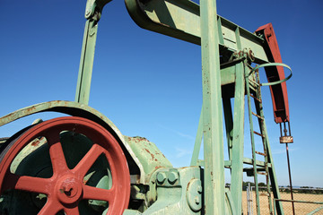 detail of small scale crude oil pump under sky