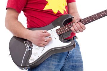 musician playing an electric guitar