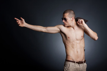 shirtless young male with sunglasses