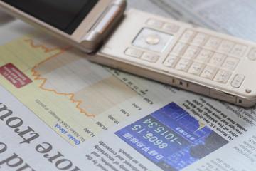 経済新聞と携帯電話