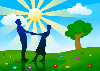 silhouettes of man and woman standing on summer meadow.