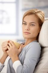 Dreamy woman with tea mug