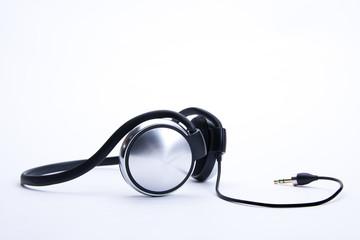 headphones with plug lie on background