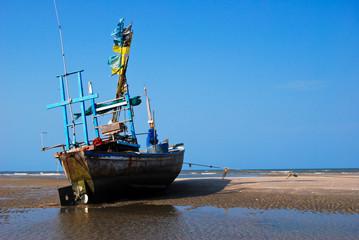 fisherman boat on the sea shore