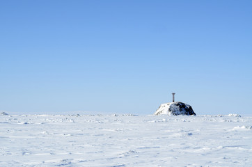 Arctic landscape with lighthouse