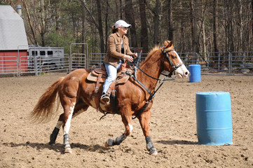 Young woman practicing barrel racing