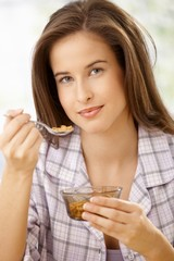 Young woman with healthy breakfast