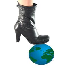Globe under woman boot