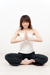 beautiful asian woman playing yoga style exercise