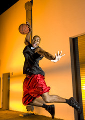 Basketball player jumps with ball