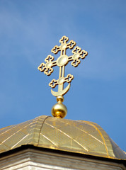 golden cross on church's dome