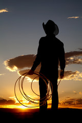 Cowboy silhouette rope down