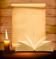 Old paper, candle and open book on wood background.
