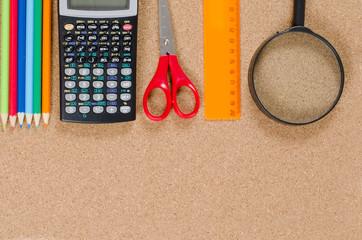 VARIOUS SCHOOL ACCESSORIES ON CORKBOARD
