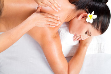overhead view of young woman receiving back massage