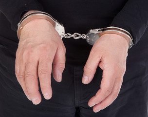 thief's hands in handcuffs