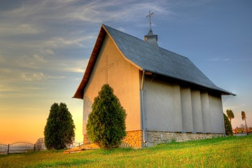 Small catholic chapel on a cementery at warm evening light