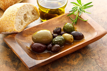 Olives on wooden plate