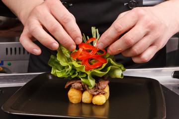 professional chef garnish tasty dish