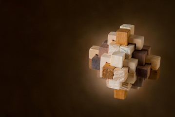 Wood Puzzle on Brown Background