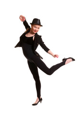 Dancing young woman in black suit.