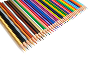 Many colorful school pencils isolated on white background