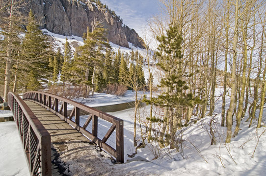 Bridge and frozen Twin Lake in Tamarack, Mammoth Lakes, CA