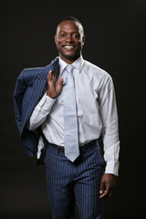 Smiling business man wearing suit. Isolated.