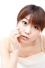 beautiful asian woman taking care of her skin