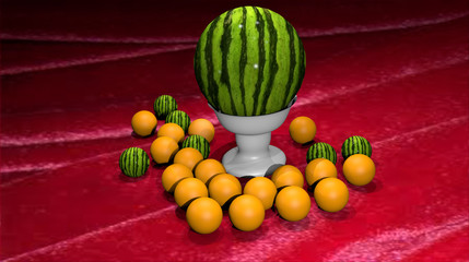 Water-melon and oranges on a table