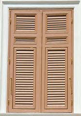 Brown wood windows.