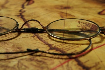 Glasses on the old map
