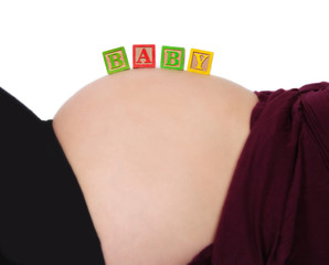 baby  blocks on bare pregnant belly isolated on white