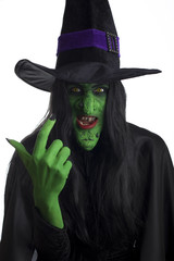 A scary witch, signaling come here. White background.