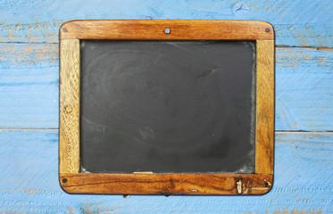 vintage school blackboard on painted wooden wall, free copy spac