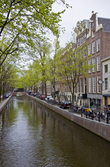 Canal in Amsterdam. Spring cityscape.