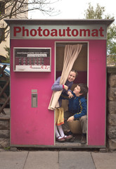 boy and girl in photo booth