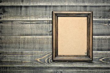 Old frame with an empty cardboard