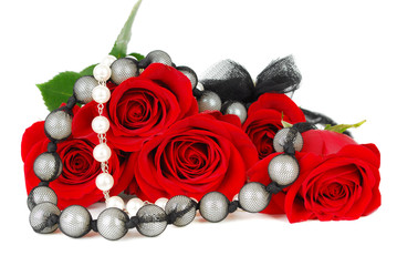Roses and jewelery.