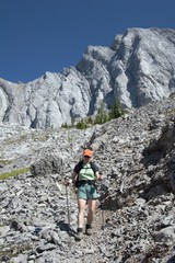 Woman Hiking On A Mountain Path