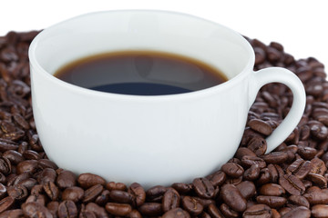 White cup of coffee surrounded with coffee beans