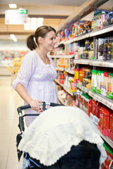 Mother with Carriage in Supermarket