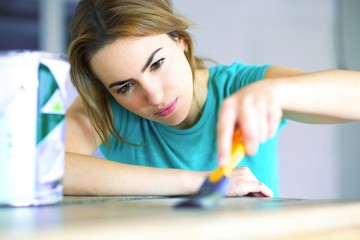portrait of young woman with painting tools