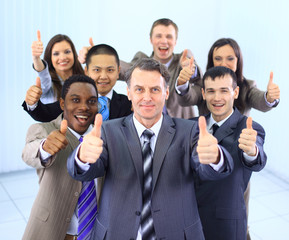 Happy multi-ethnic business team with thumbs up in the